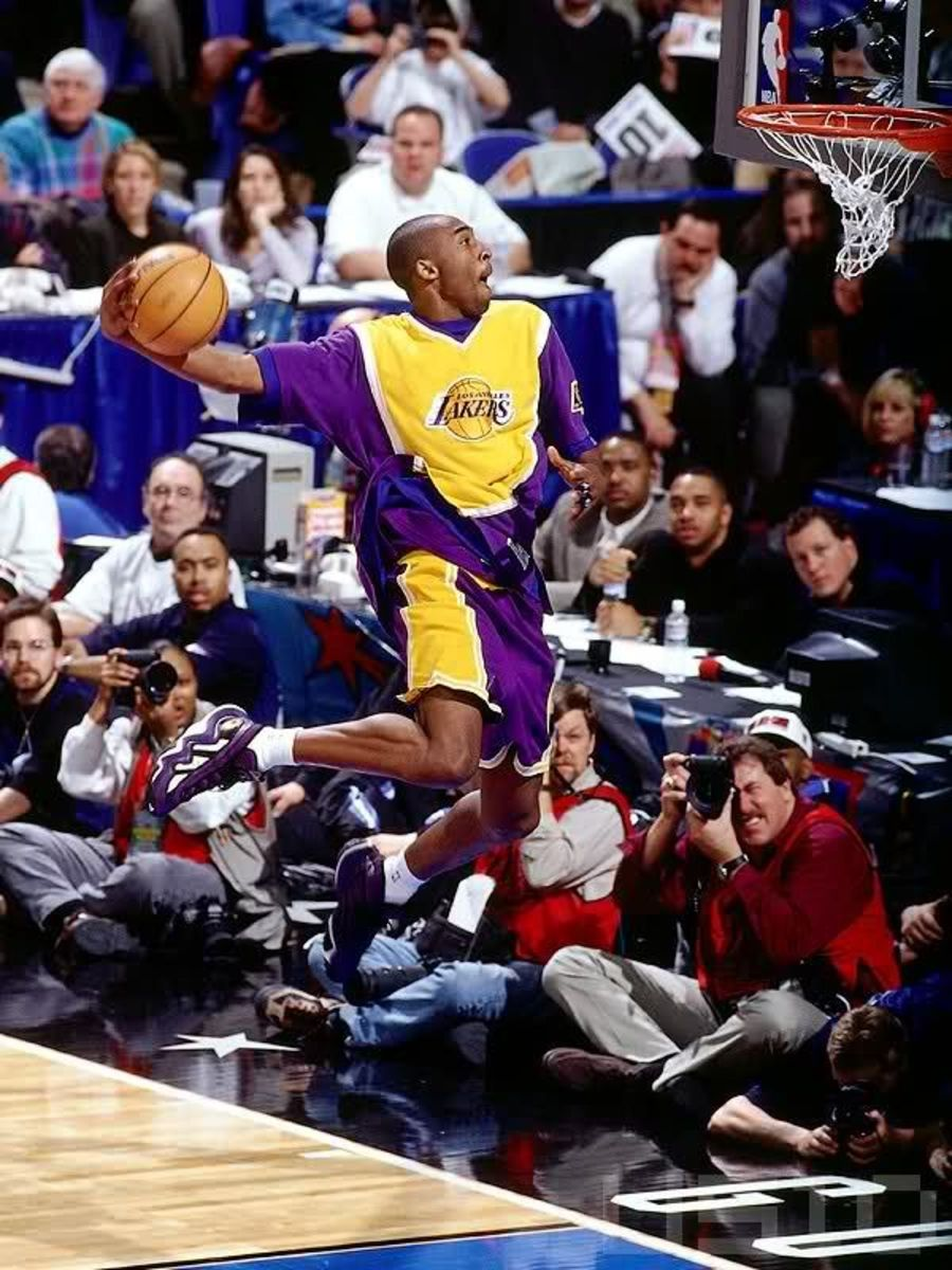 Kobe Bryant caps off the Slam Dunk Contest with a between the legs dunk.