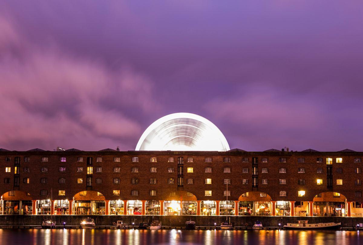 The Liverpool Wheel twirls above the historic Albert Dock.