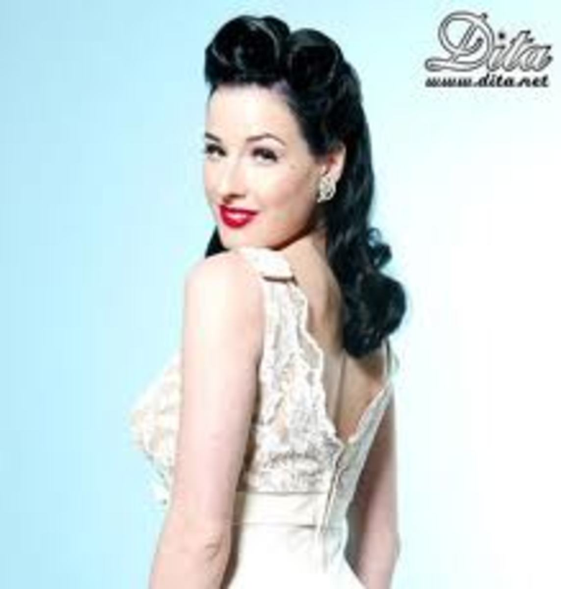 The gorgeous Dita Von Teese wearing her hair in victory rolls.