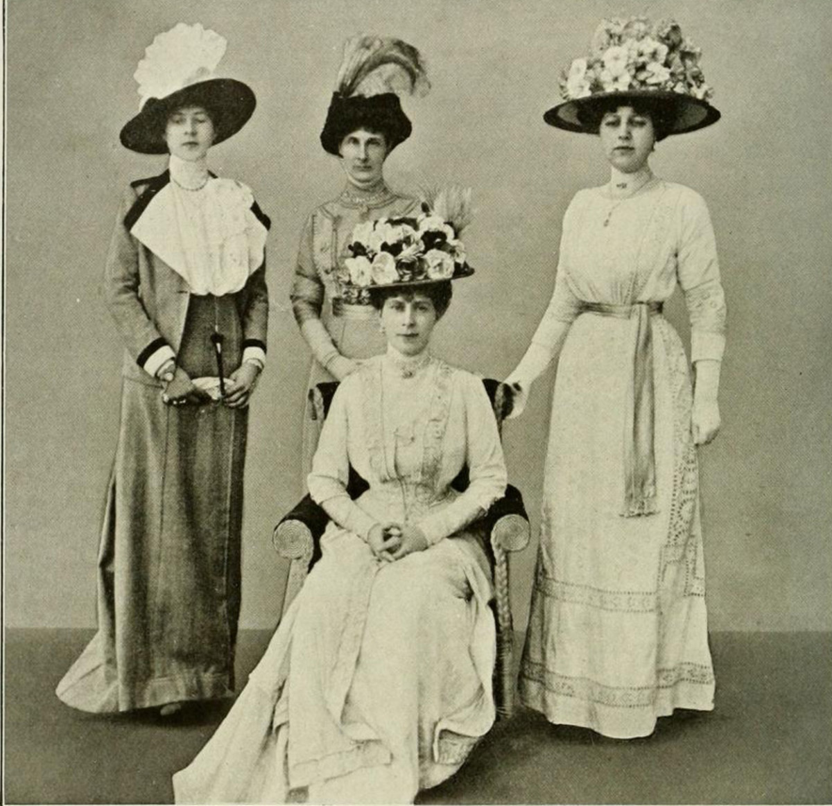 Big hats: Queen Mary and ladies 1911.