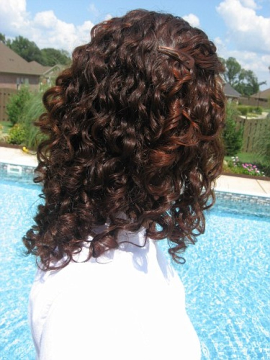 Henna combines with your natural hair color. When used on dark brown hair, it forms a dark auburn color.