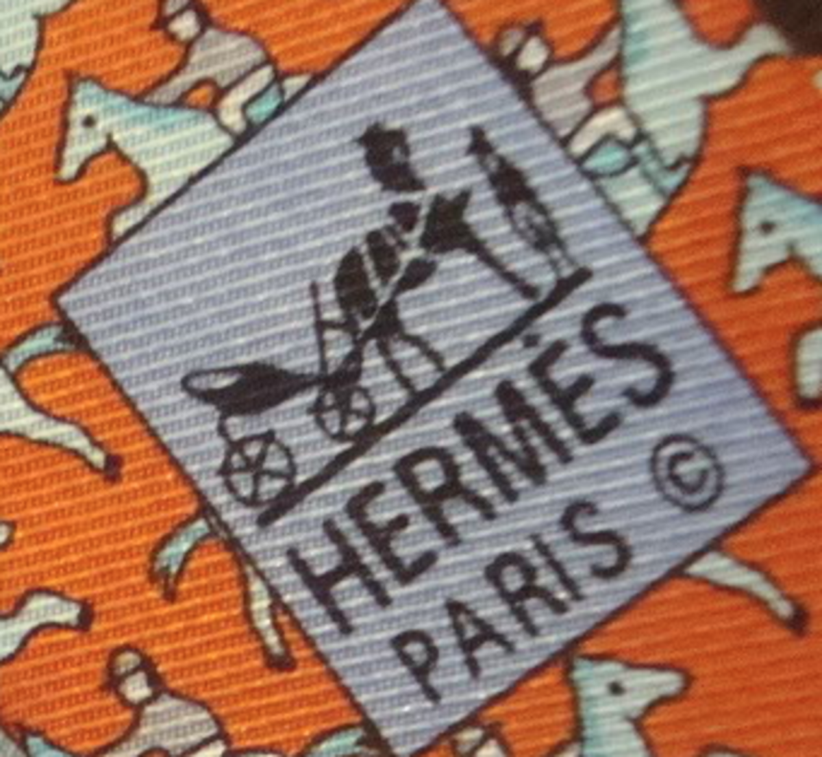 Look at the twill direction.  It is not running 11 to 5.  It is more East-to-West than a genuine Hermes tie.
