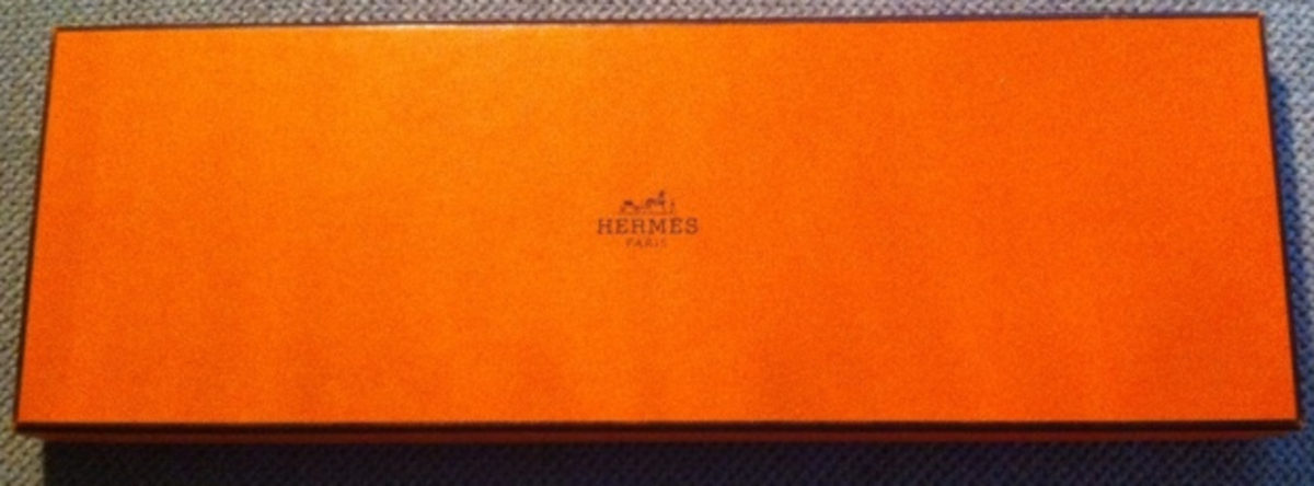 Real Hermes tie boxes are a distinctive bright orange.  Fakes will be off-color and may not have the same font on the printing.  This one is legit!