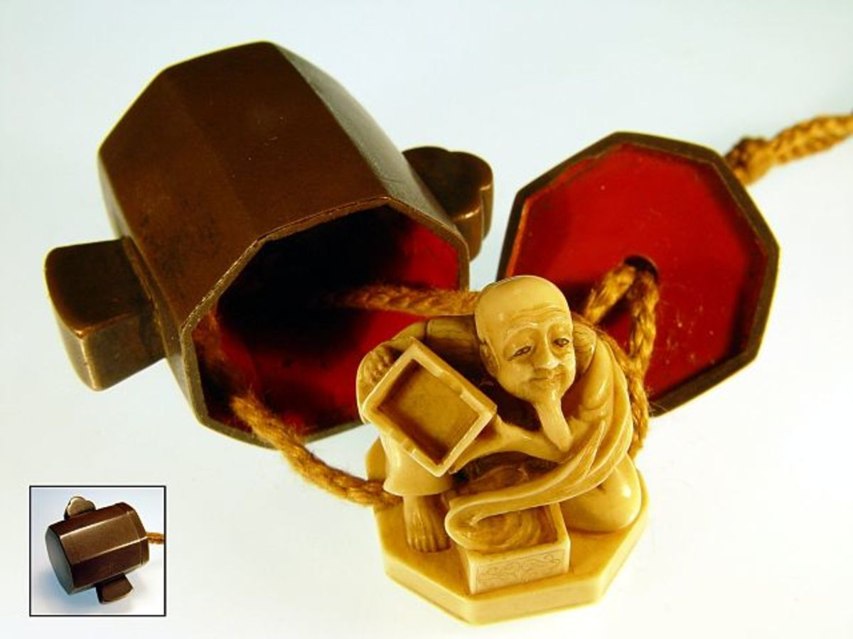 "An Edo period ""trick netsuke"" of Daikoku's hammer. When opened, an ivory netsuke of Japanese folk hero Urashima Taro appears in the hammer."