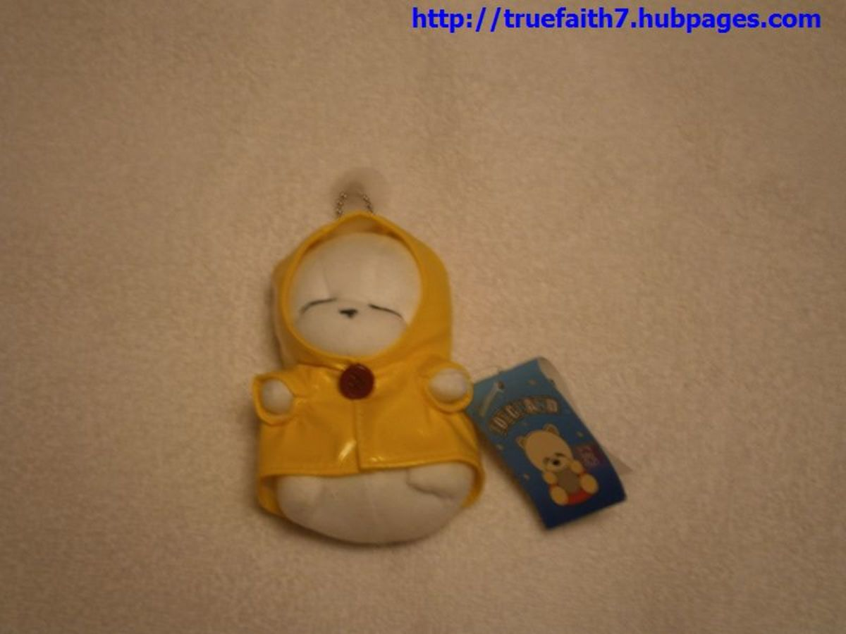 A stuffed Mashimaro keychain/cell phone charm from South Korea. This one dates from sometime in the early 2000s .