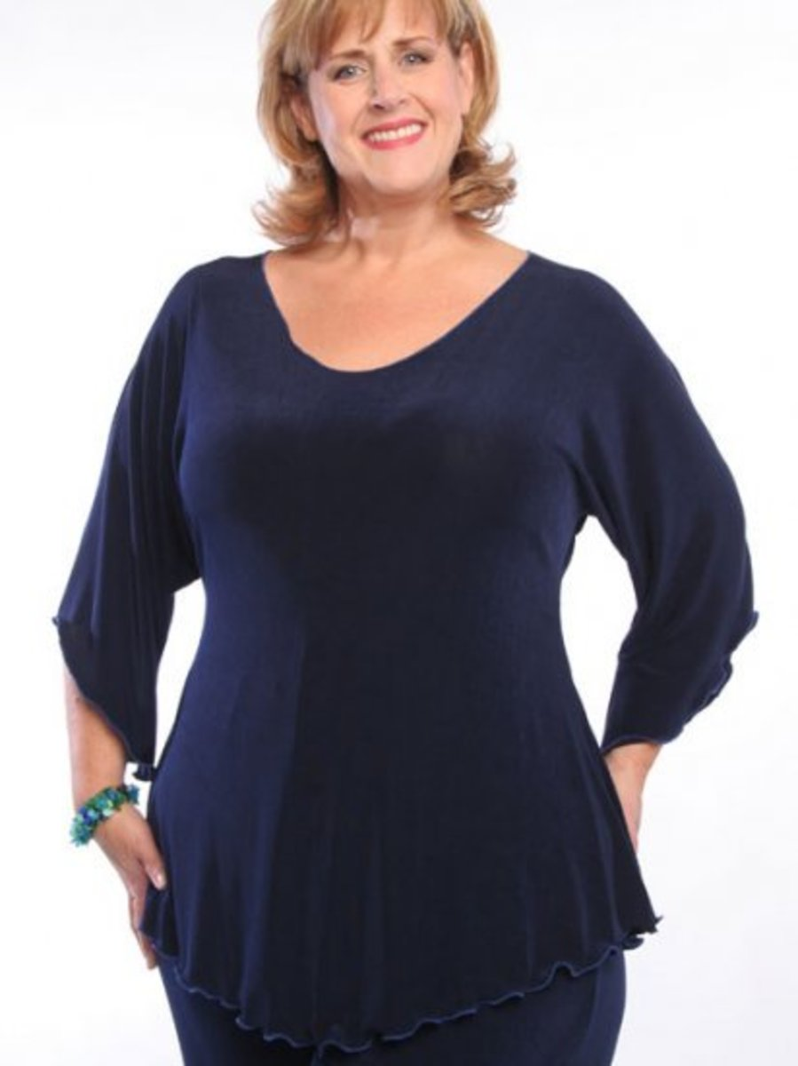 This tunic, with its deep neck and crease proof fabric, is ideal for a travel wardrobe. The shaped hemline makes it ideal for the plus size figure and helps to make legs look longer.
