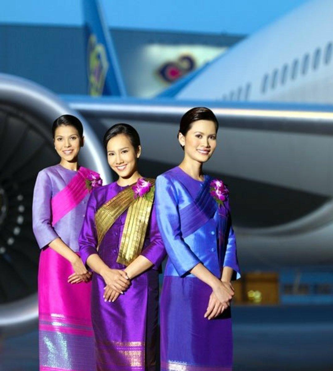Thai Airline flight attendants in their Thai traditional uniform worn when in the plane