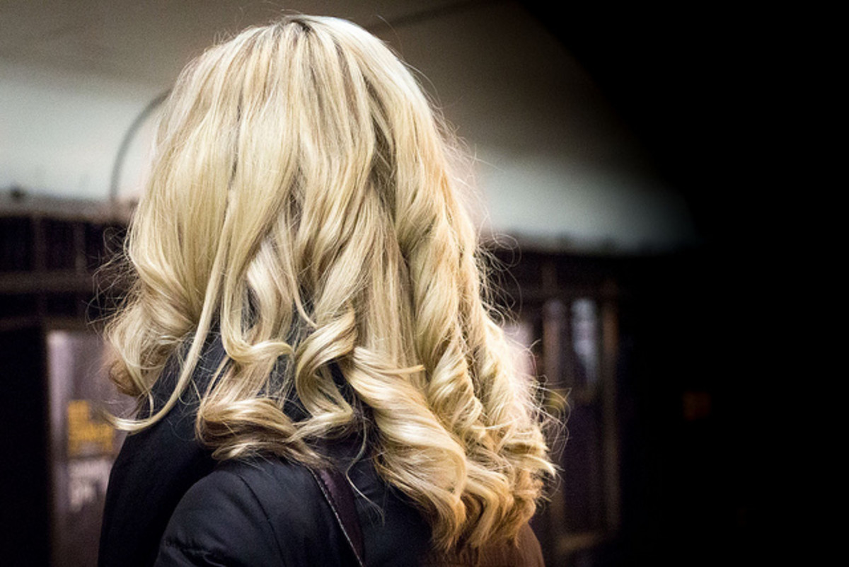 Curly blonde hair is truly beautiful.