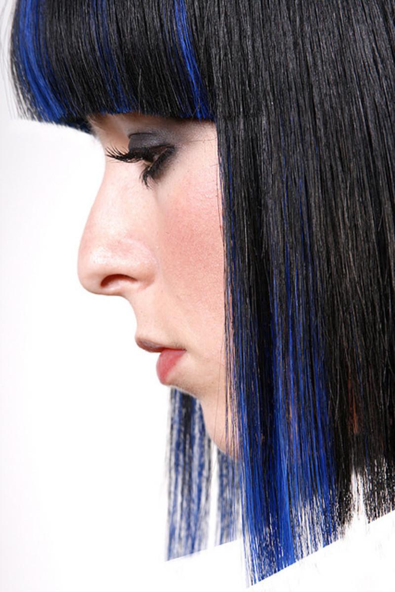 Blue streaks and chunks in black hair.