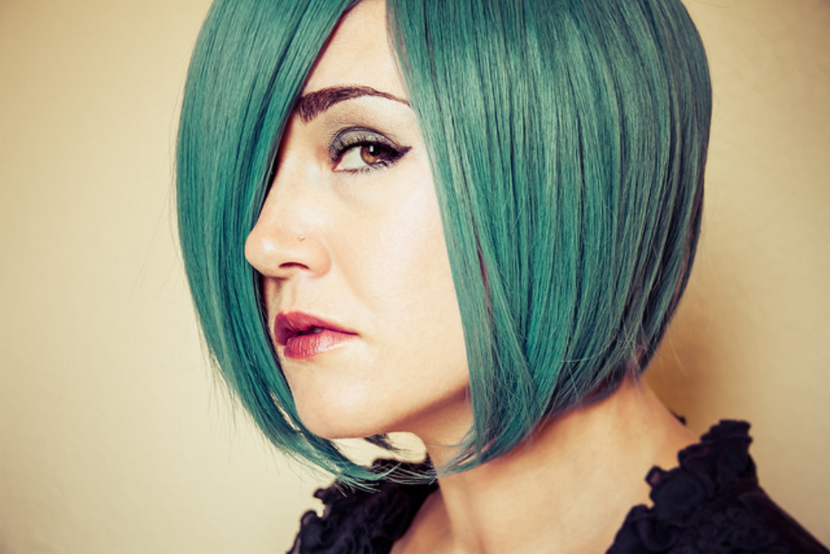 Turquoise green hair. A little green color added keeps the color blue but completely transforms the shade.