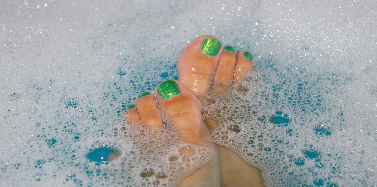 Before beginning a pedicure, allow nails, cuticles, and calluses to soften in either the tub, the shower, or a foot bath.