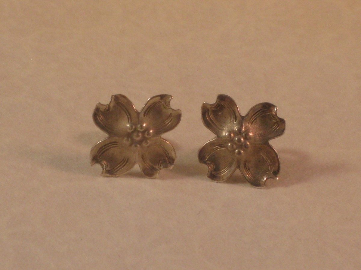 The earring placed in boiling water is on the left. The earring placed in warm tap water is on the right. Notice the right earring is still much less tarnished than it was prior to the bath!