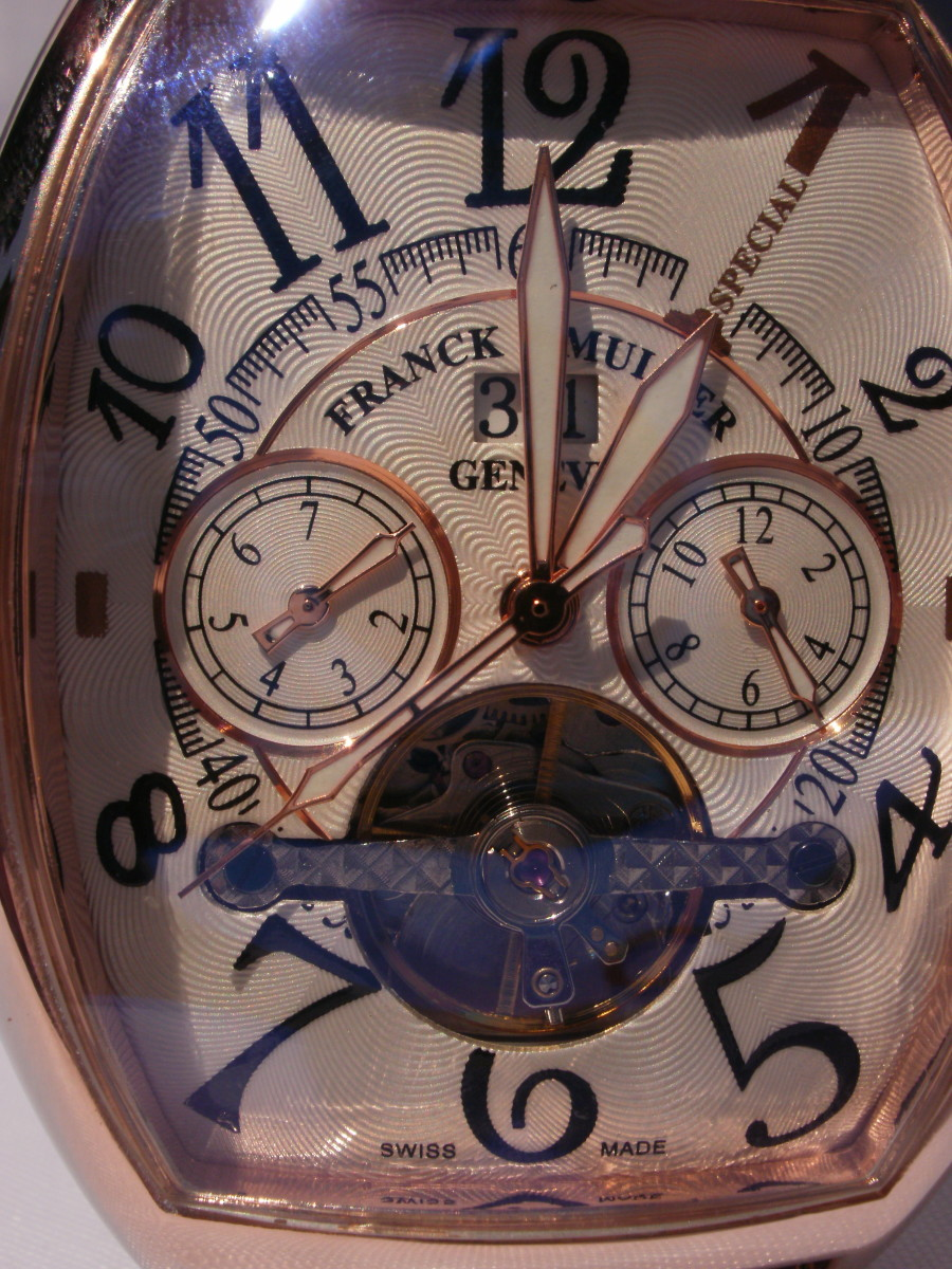 Information on dial fraudulently identifies the timepiece as being a Swiss made, Franck Muller watch manufactured in Geneva.