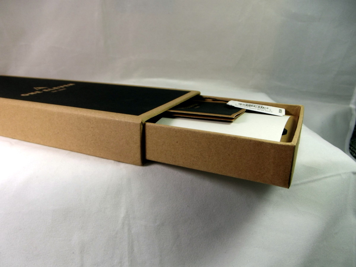 Box containing a One Eleven CMP0002 solar powered quartz watch with leather strap.  This box is composed of recycled cardboard