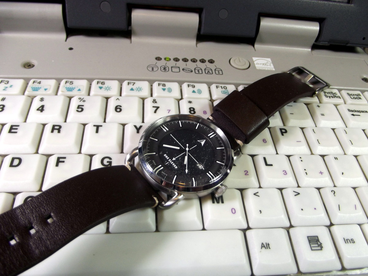 One Eleven CMP0002 solar powered quartz watch with leather strap.  This timepiece is perched upon my much loved Itronix GoBook 3 laptop