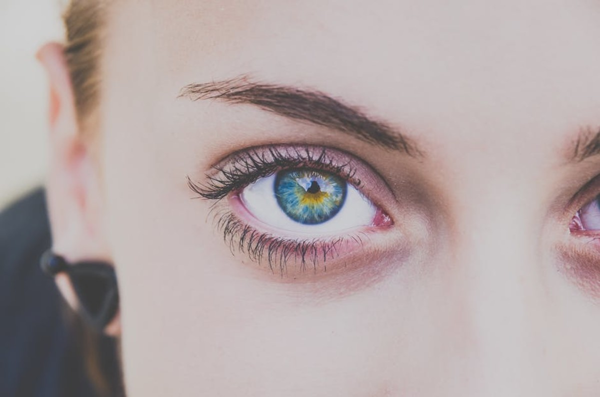 Young girl wearing only mascara showcasing her naturally beautiful eyelashes without overdoing it.