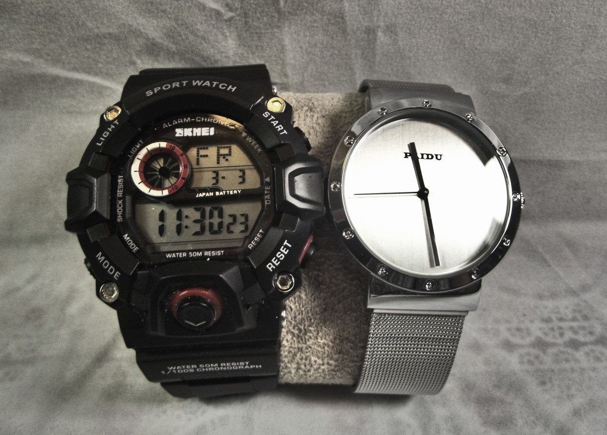 Paidu 58919 Analog Watch alongside a similarly priced Skmei product.  This demonstrates the contrast between a simple and a complicated design.