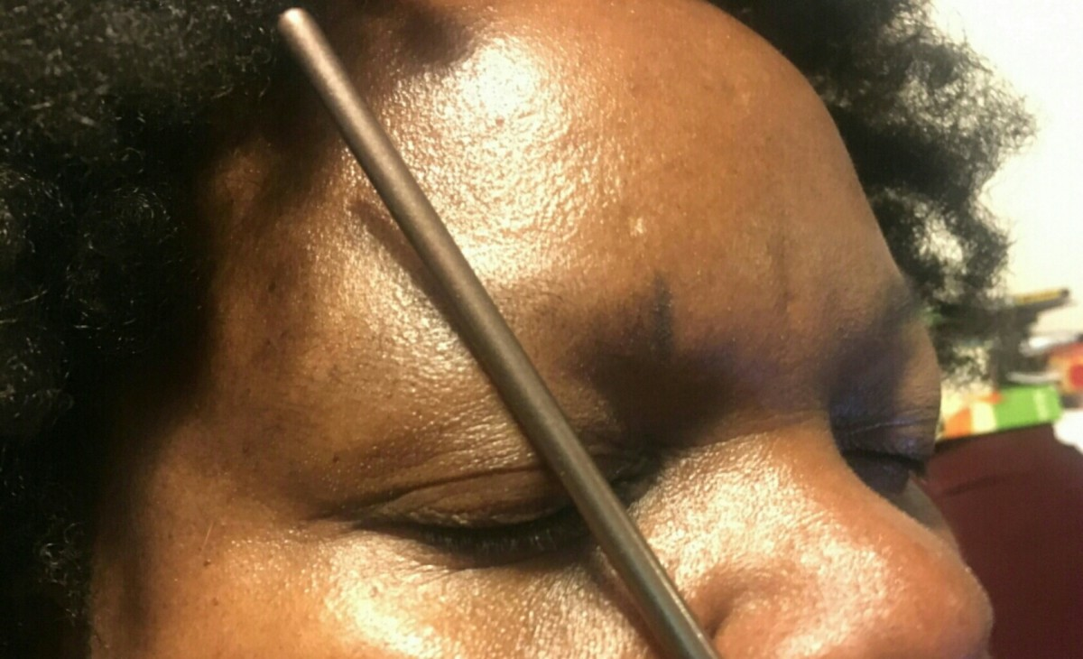Step 2: Placing the mark for where the arch of the eyebrow will go.