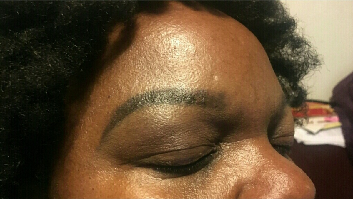 Step 7: Cleaning up the eyebrows using concealer.
