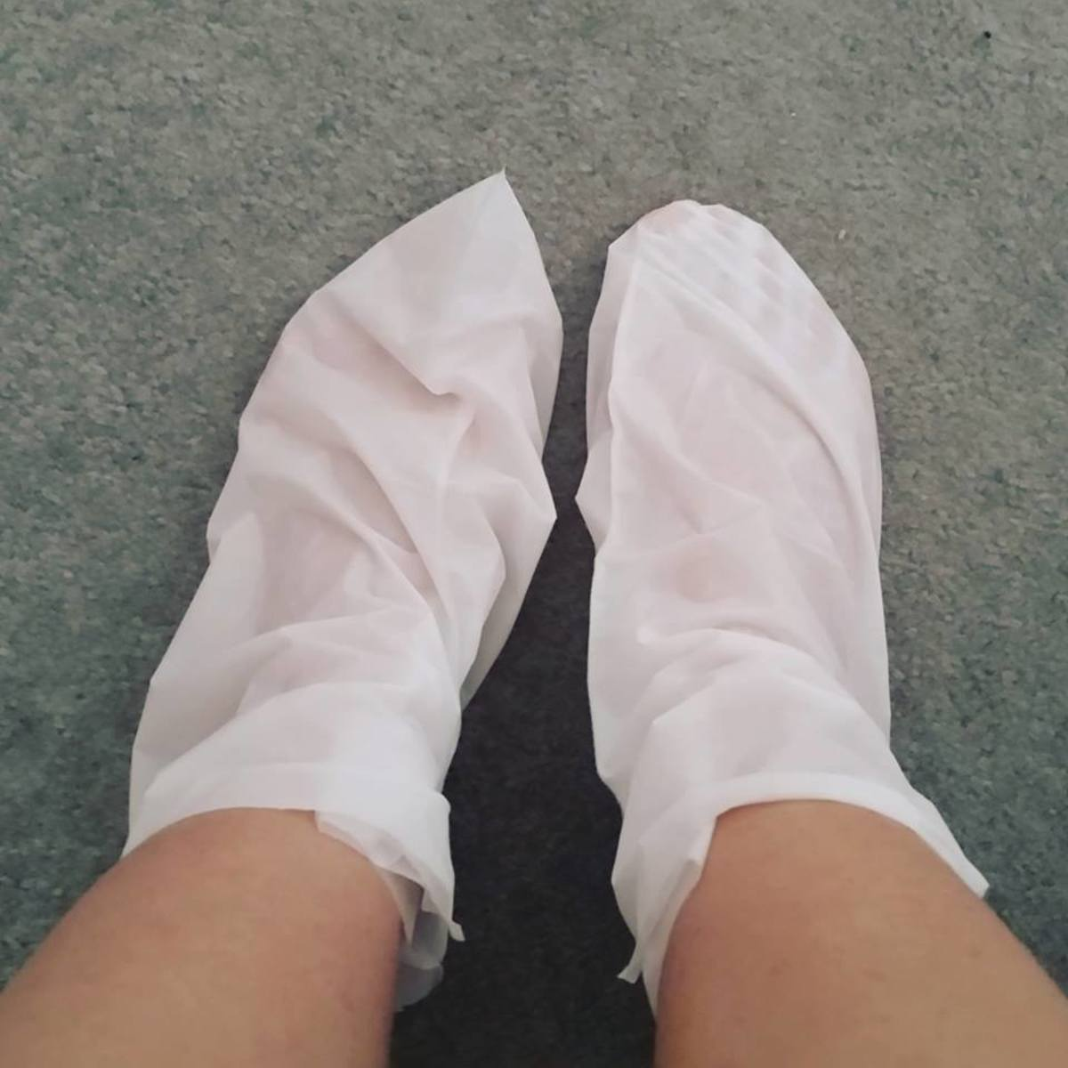 A picture of the Derma V10 Tea Tree and Peppermint Deep Moisturising Foot Pack in use.