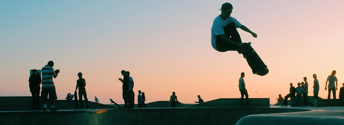 Sunset skating in workwear brands.