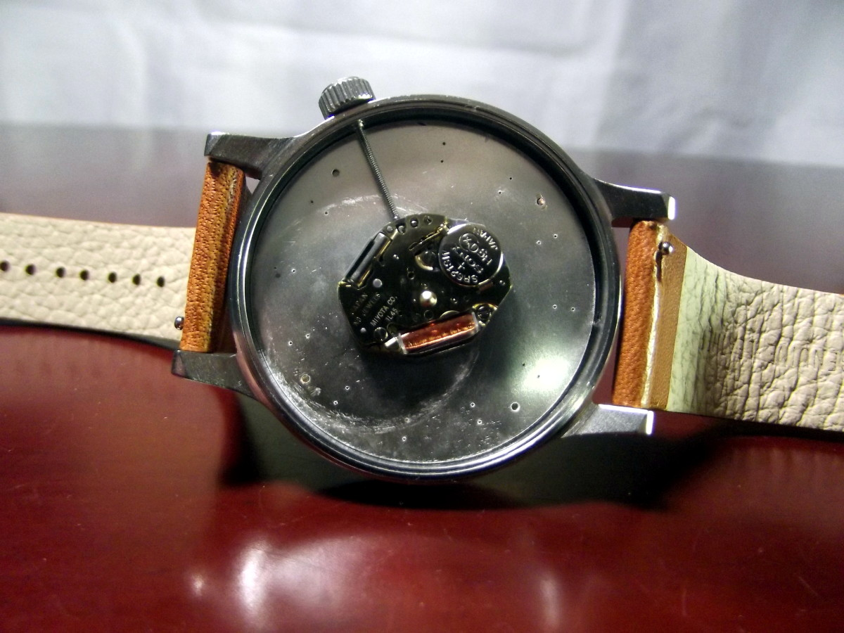 Komono Winston Quartz Watch with caseback removed.  Note the tiny levers which allow easy removal of the strap