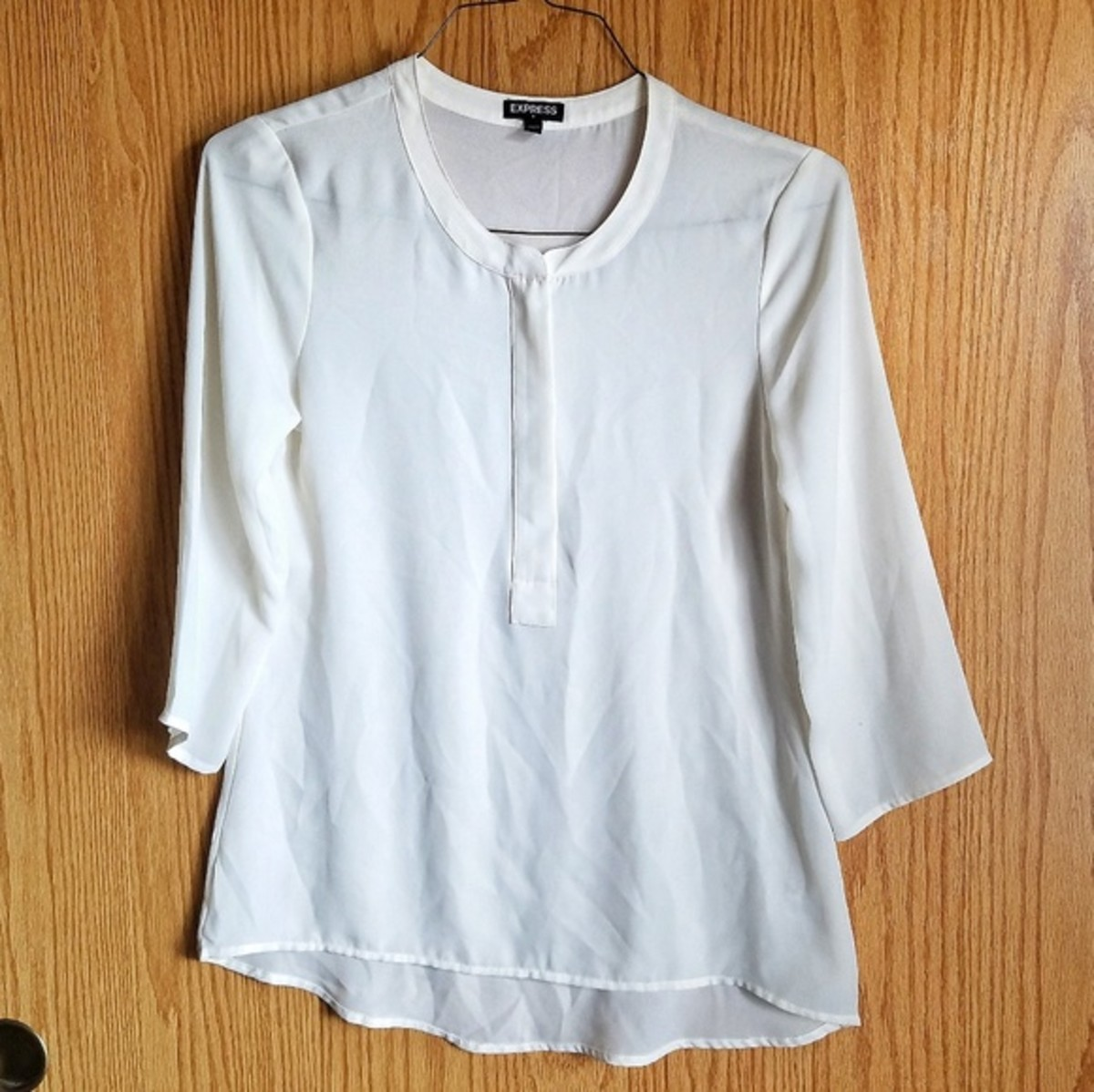 This is an Express brand blouse I bought used on Poshmark.