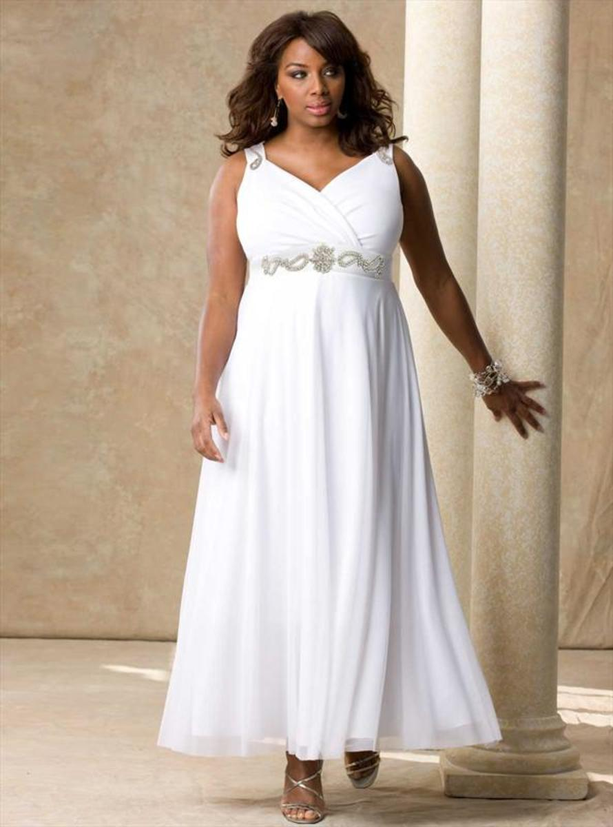 White diamonds gown. This exquisite gown is beautifully accented with dazzling hand-made crystal pieces.