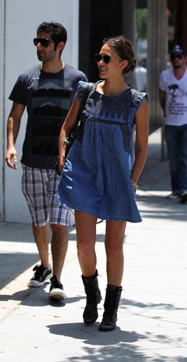 Jessica Alba wearing an Isabel Marant denim dress paired with chunkier boots.