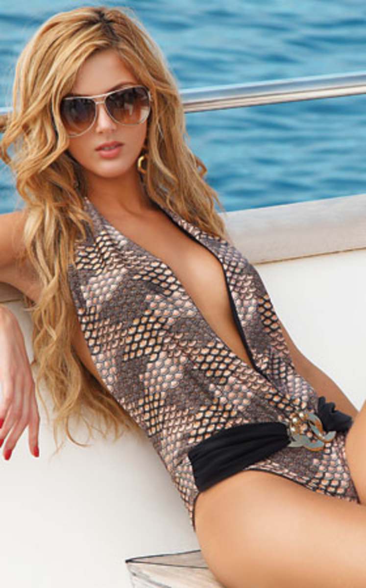 A daring plunging neckline and belt push this suit over the top.