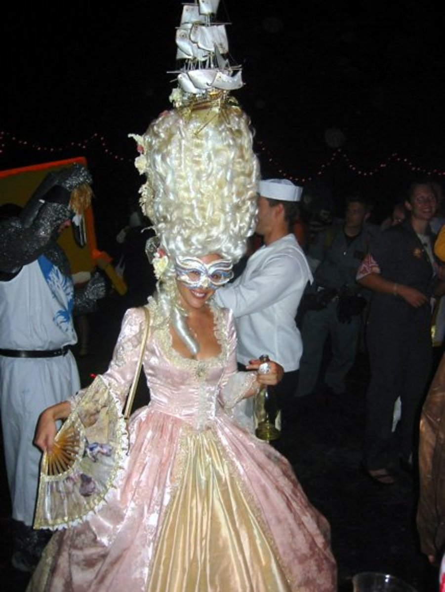 Marie Antoinette costume, complete with maritime scene on the top of the towering hairdo.