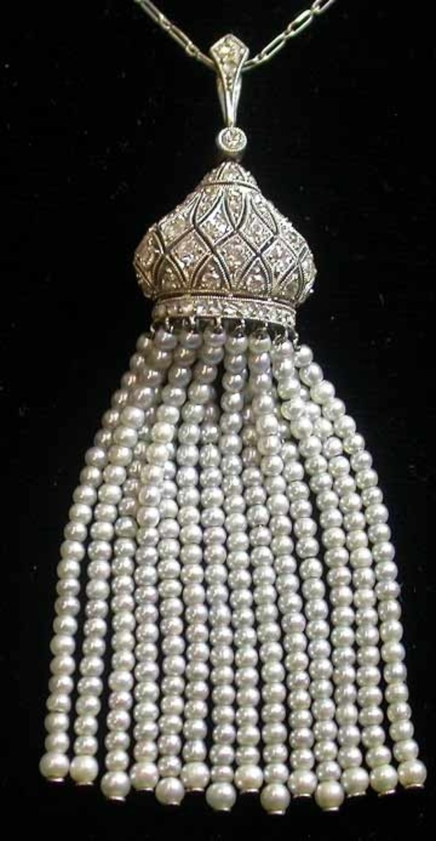 Edwardian platinum and diamond necklace with pearl tassel.