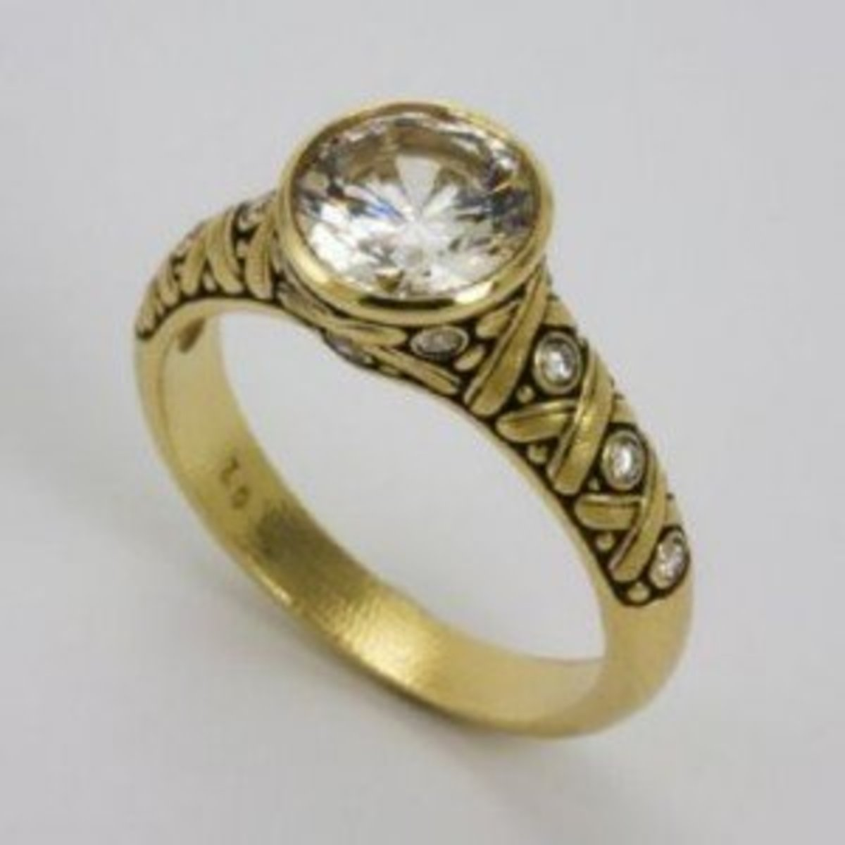 Unique 18kt yellow gold engagement ring by Alex Sepkus.