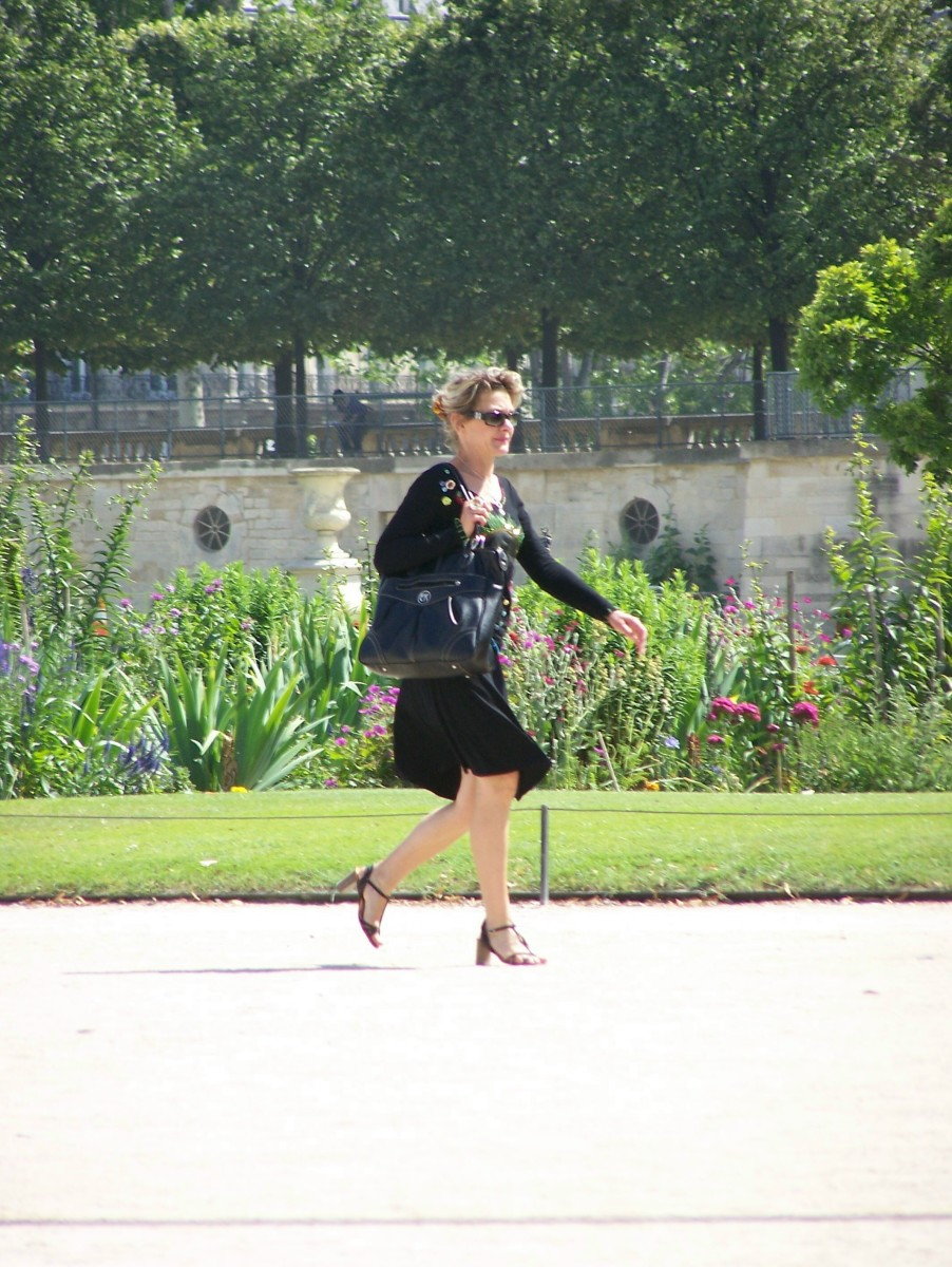 a woman walking dressed in all black