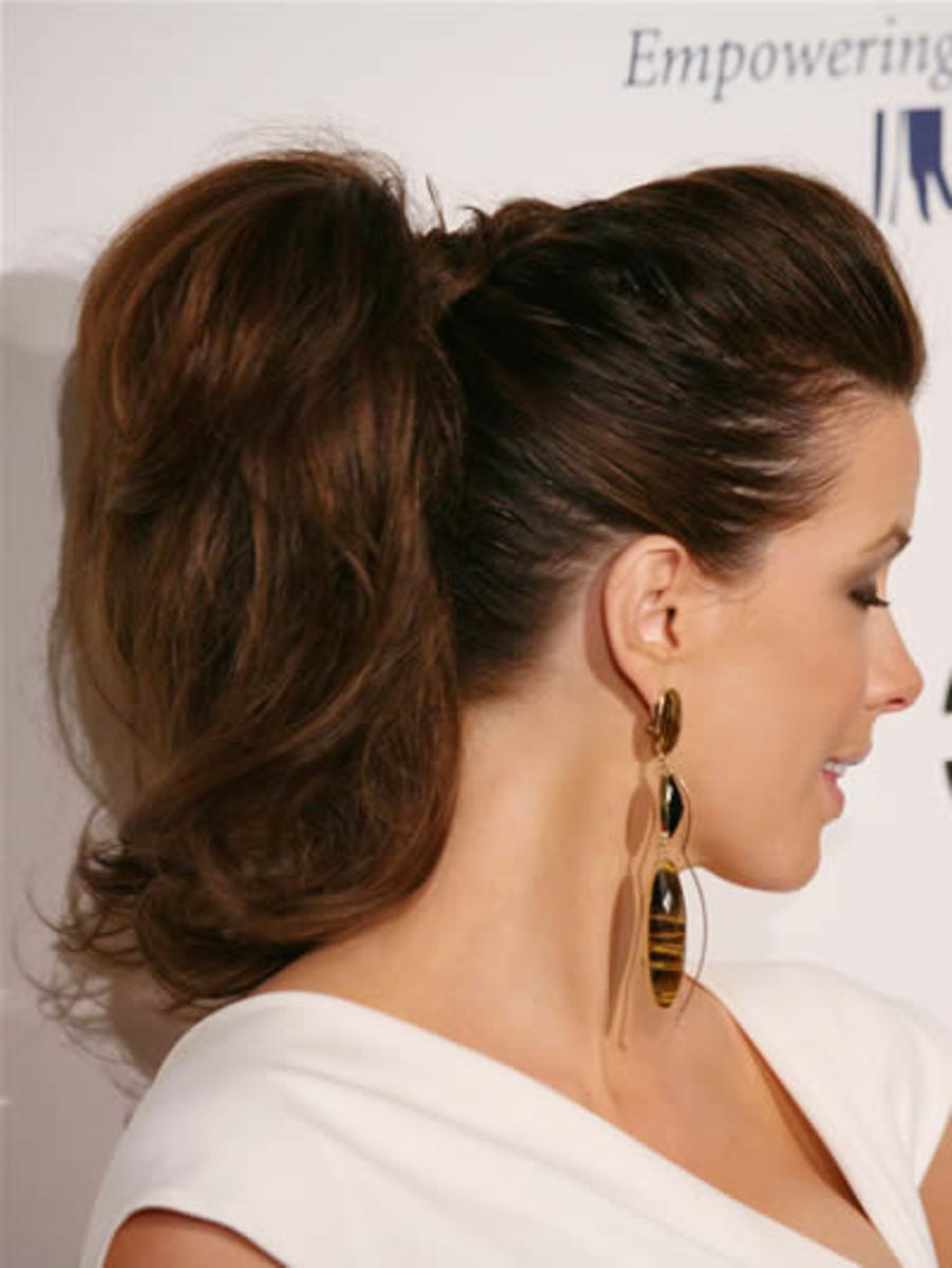 Back-brushed hair on top of head with volume and save in high ponytail.