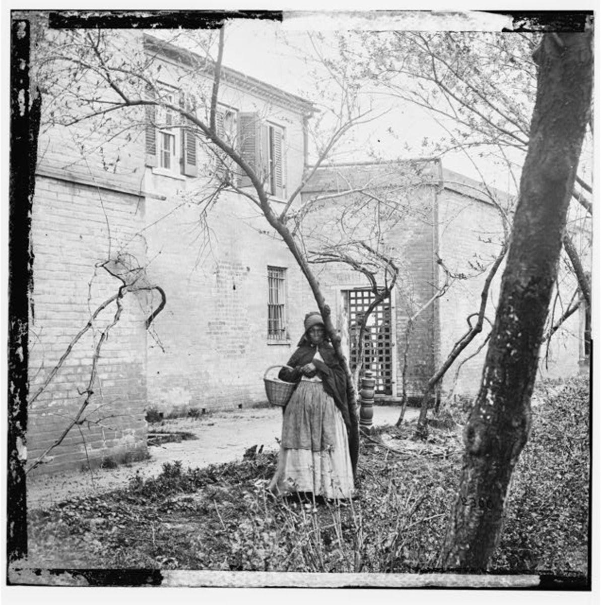Slave wearing bonnet and apron
