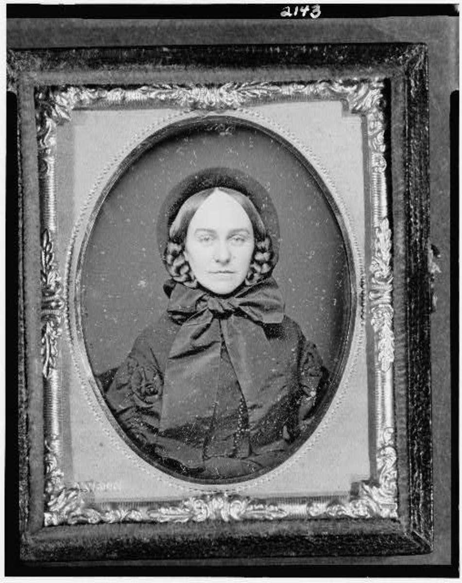 Civil War era woman wearing bonnet with a large bow