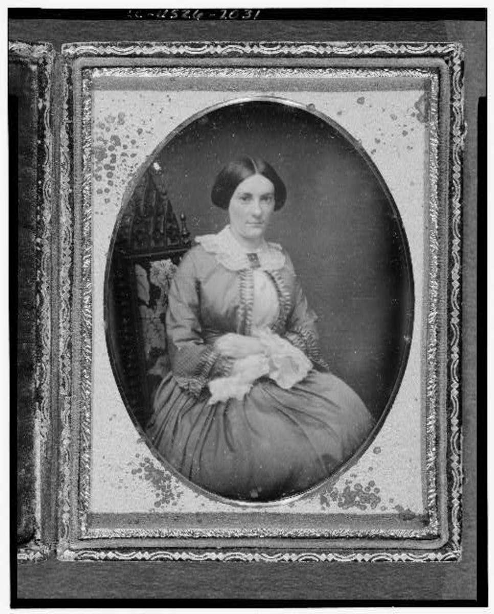 Civil War era woman wearing lace cuffs and collar
