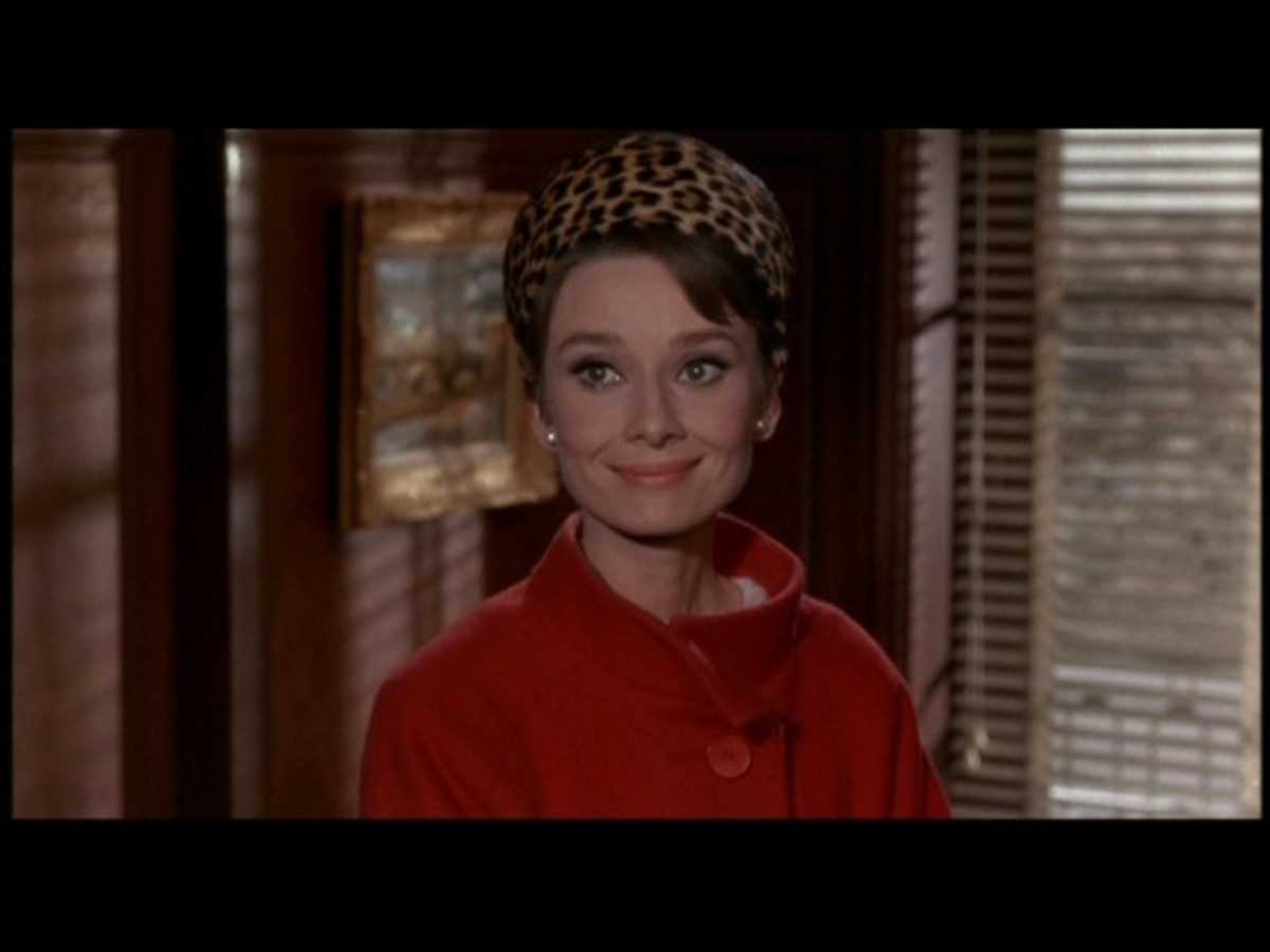 "Hollywood followed the Kennedy lead. Here's Audrey Hepburn in a pillbox hat in the film ""Charade."""