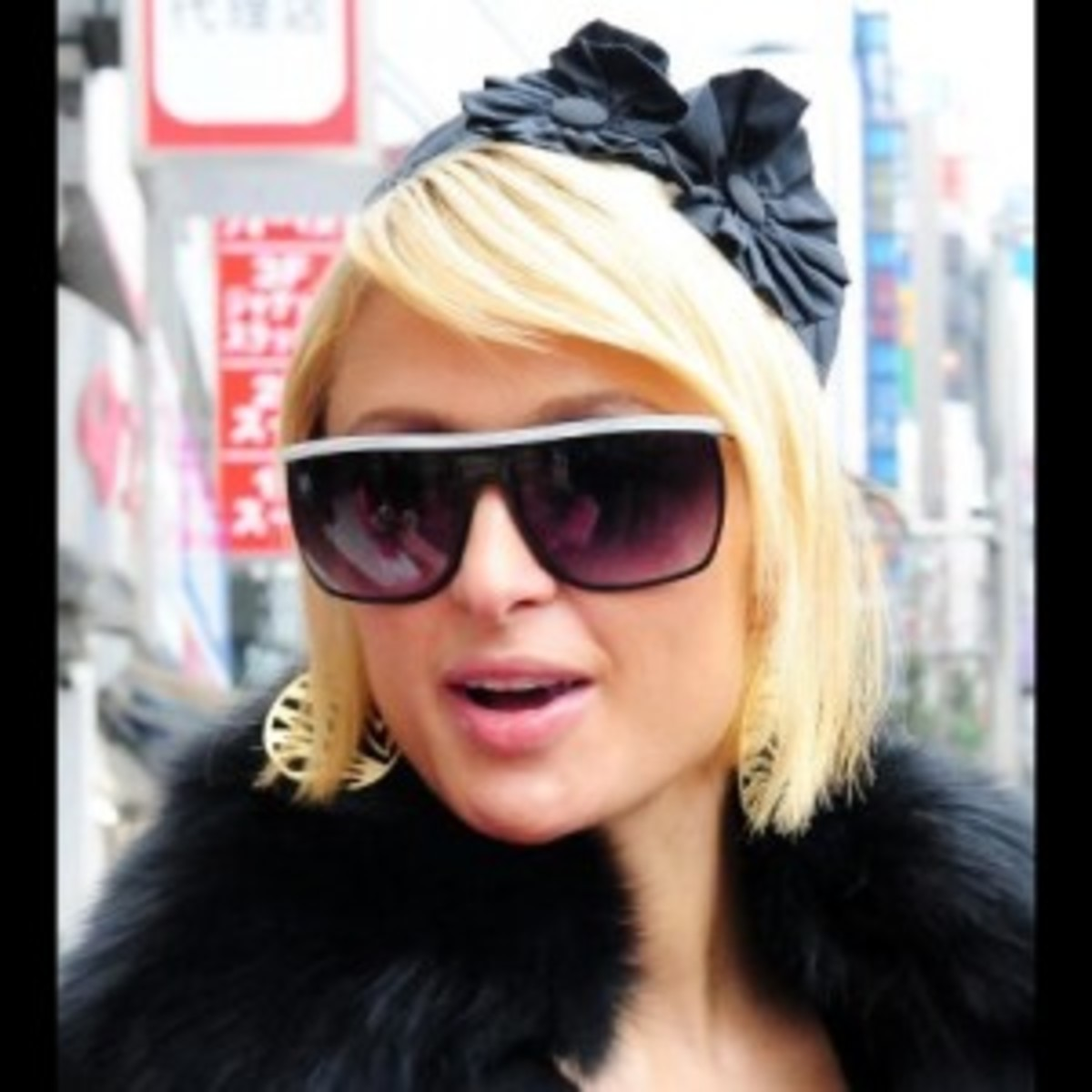 Paris Hilton sports a retro pillbox, proving the pillbox is forever.