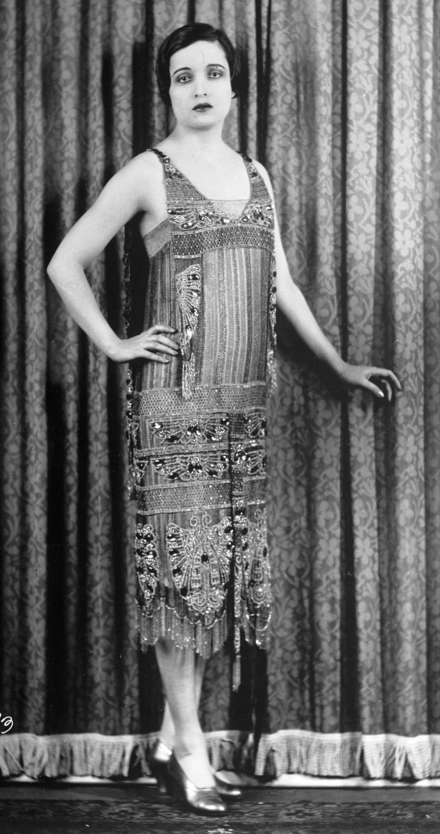 1926 Fashion - Beautiful beaded dress features an ancient Egyptian style From the US Library of Congress