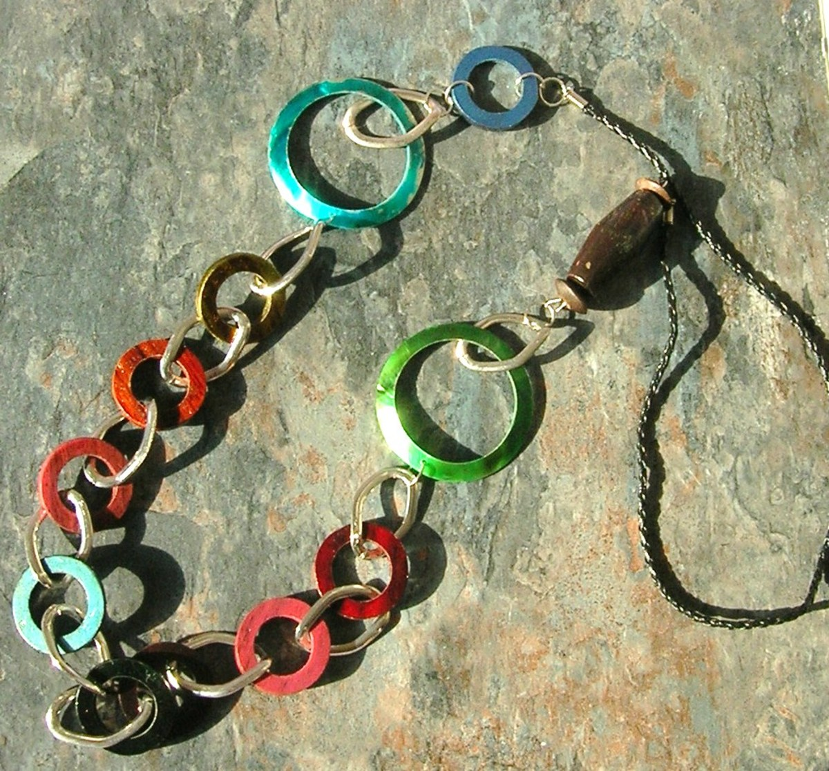 Accessorize your swimsuit with bold items, like this colorful boho necklace.
