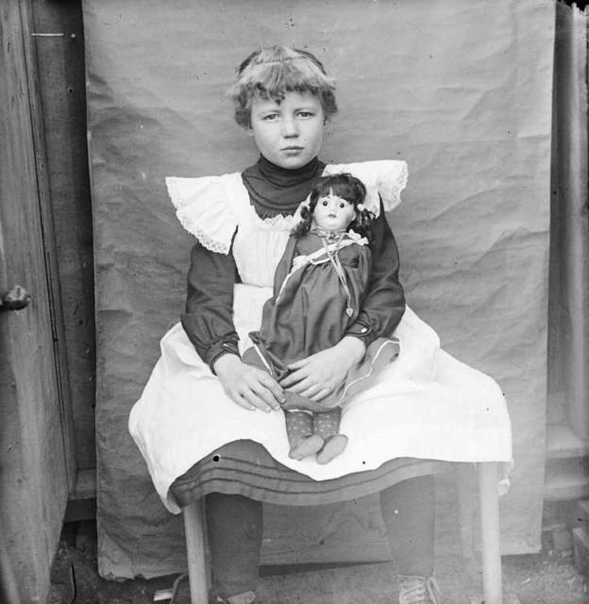 Child Wearing a Pinafore