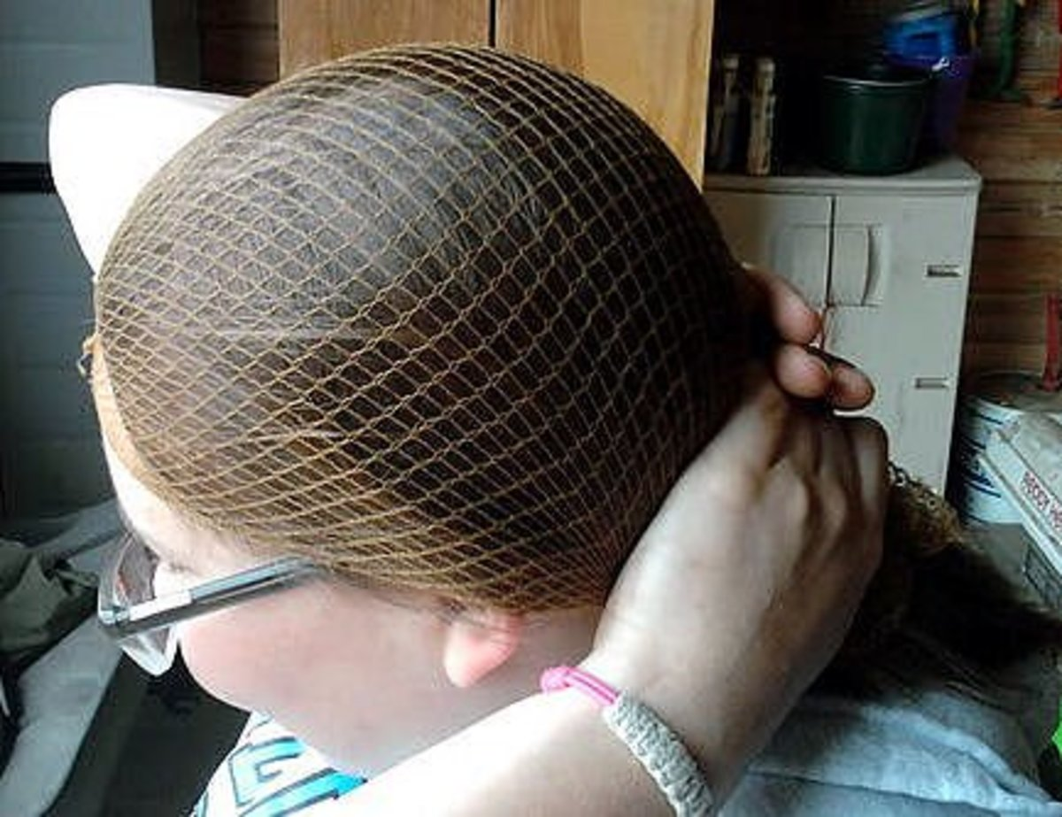 Step four: Secure your hair and hairnet into a low ponytail.