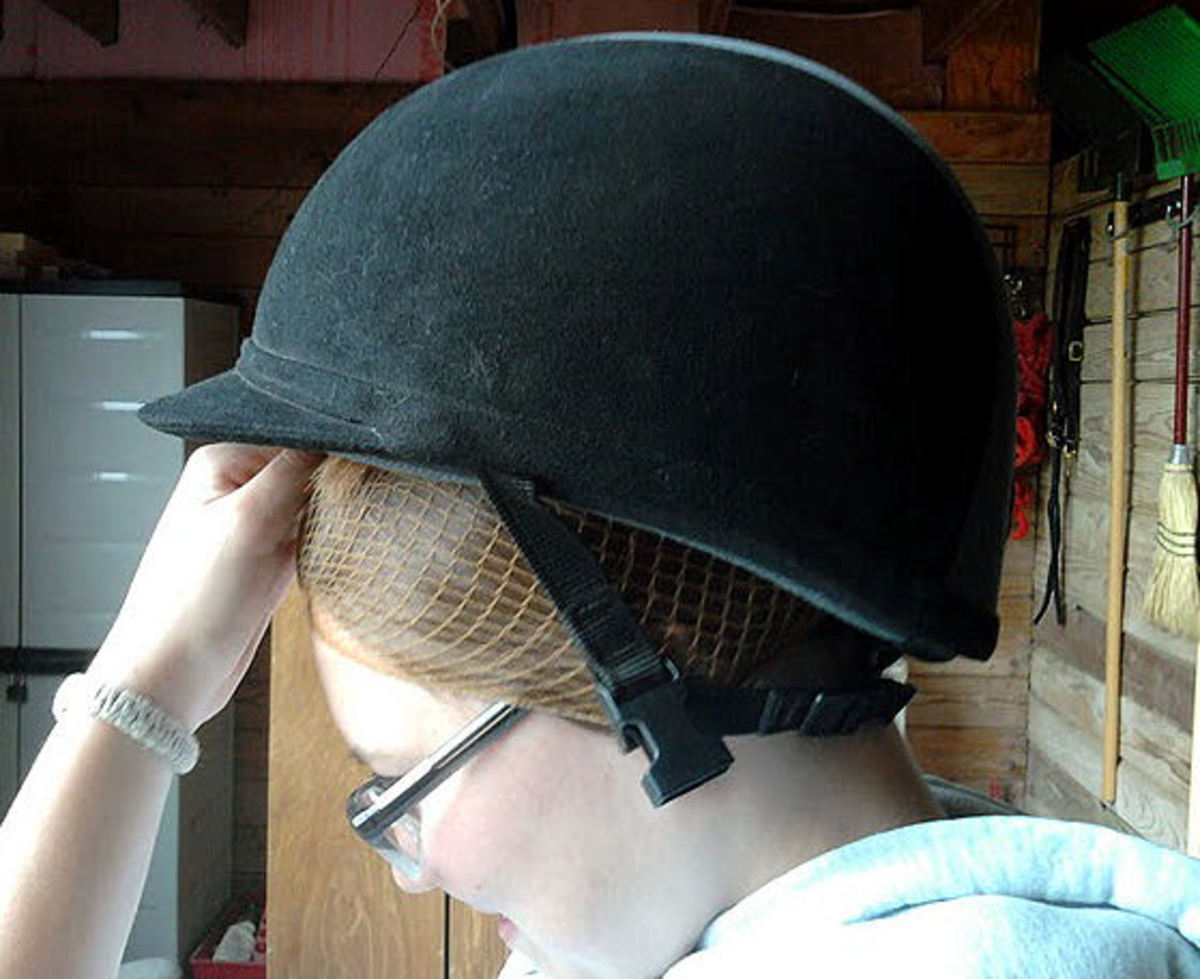 Step nine: Put helmet on over the hairnet back to front.