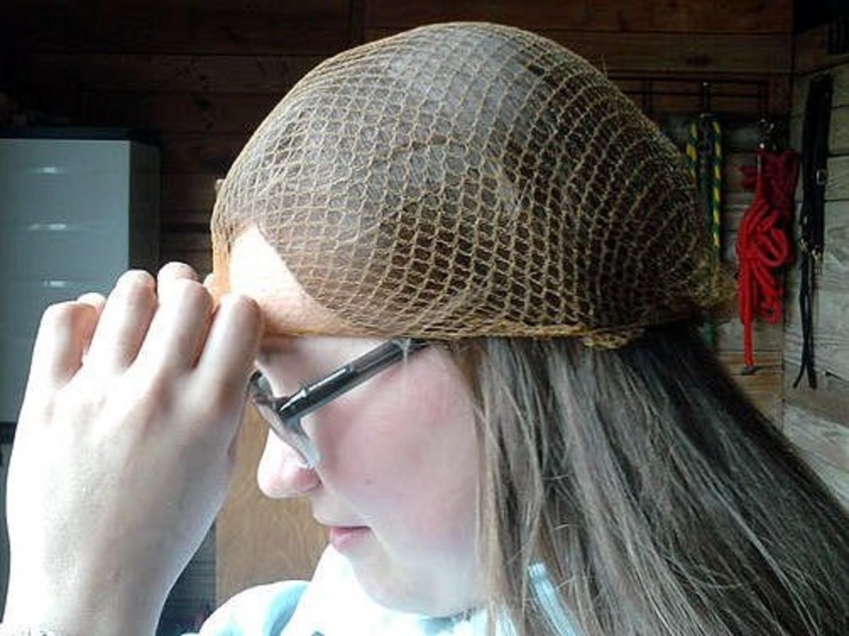 Step two: Place the hairnet over your hair and tie a knot in it right above your eyebrows.