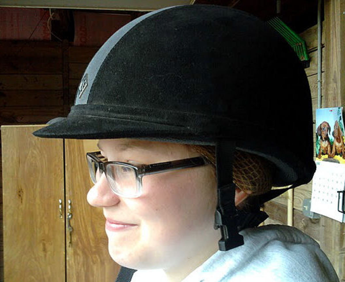 Step ten: Finish adjusting hair so that it remains under the helmet. Piece of cake. Now if only riding were this easy!