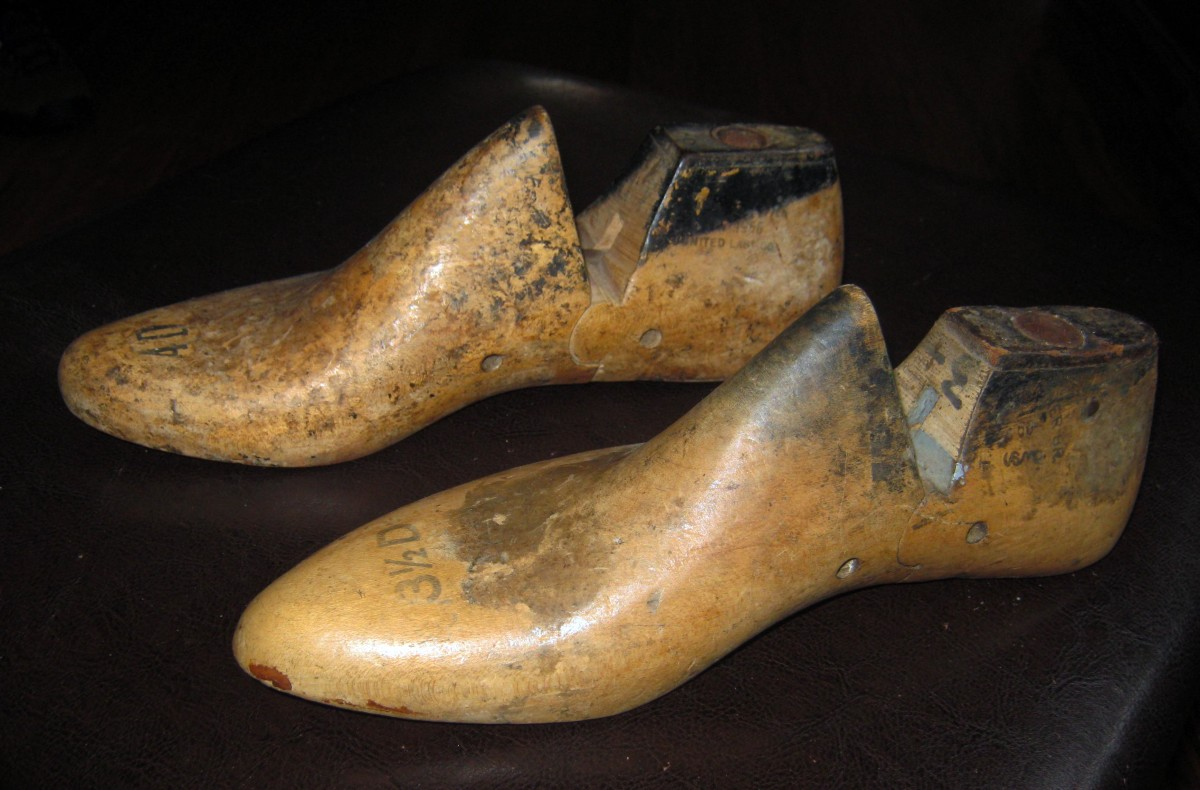 Vintage wooden shoe forms used in the production of footwear.