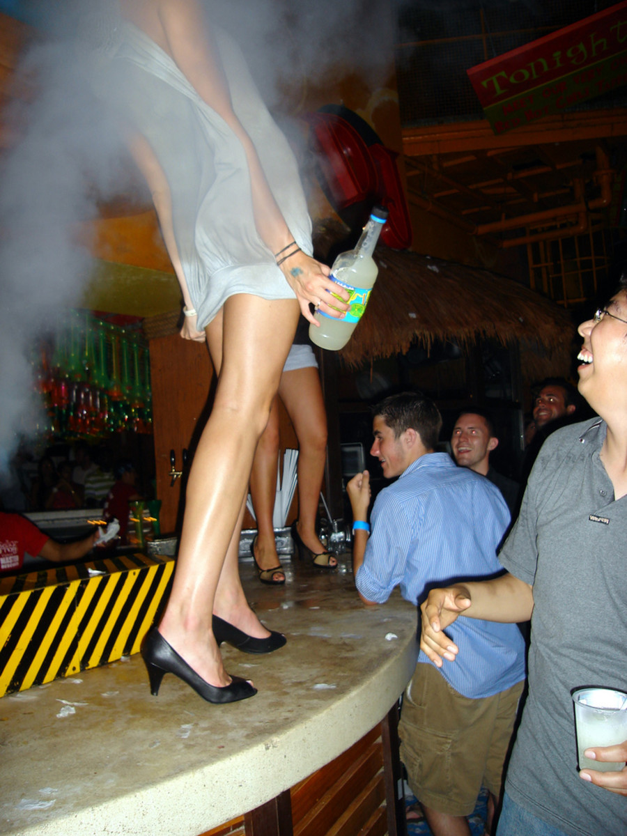 She's not slutty; she's just enjoying the smoke machine from a better vantage point.