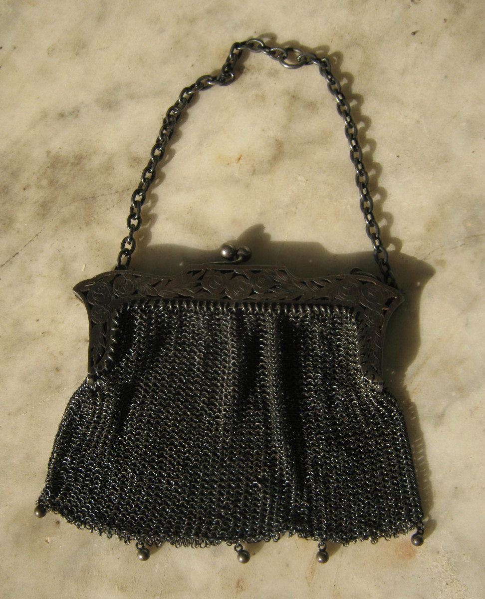Vintage metal mesh bag with embossed metal frame from the early part of the 20th century